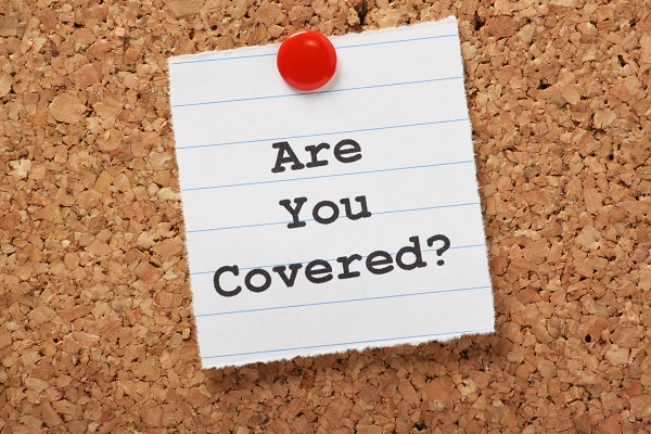 travel insurance, post it, cork board, are you covered