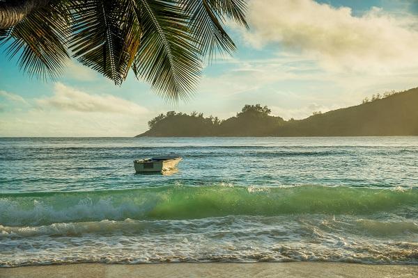 Tropical beach Baie Lazare at sunset, Mahe island, Seychelles