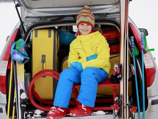 Winter, skiing, journey - girl with ski equipment ready for trav