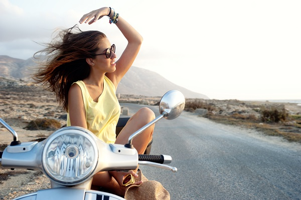 Young female in motorcycle trip