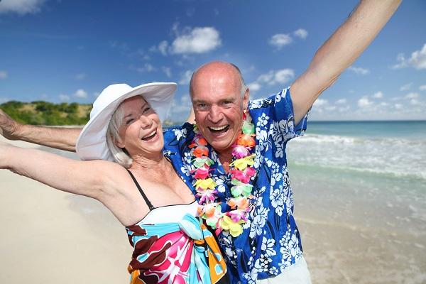 Happy senior couple at tropical beach