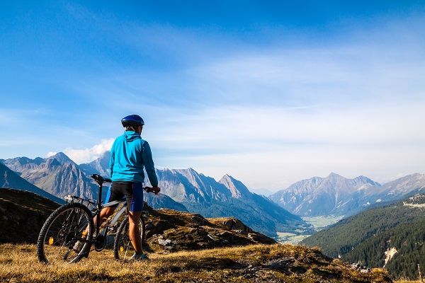 Mountain biking - woman on bike, Dolomites, Italy