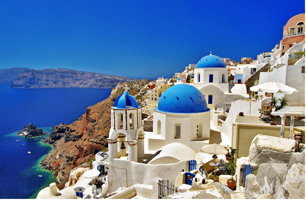 view of the white building with blue roofs in Santorini, Greece